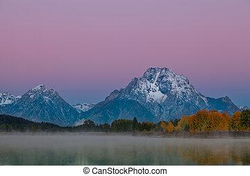 Teton Alpenglow Reflection - a reflection of the tetons pre...