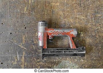 Old used red air nailer or nail gun carpenter tools - Old...