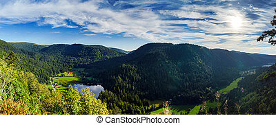 Beautiful mountains with small lake panoramic view