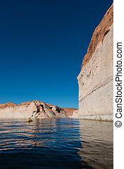 kayaker paddling the calm waters of Lake Powell Utah