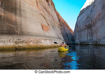 kayaker paddling the calm waters of Lake Powell Utah - Woman...