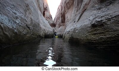Lost Eden Lake Powell - Kayaker in the narrows Lost Eden...
