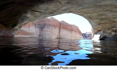 Sunlight Reflecting inside Arch Lost Eden Lake Powell - Lost...
