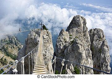 Hanging bridge in mountains