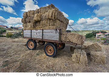 Vintage tractor trailer fully loaded with bales of hay -...
