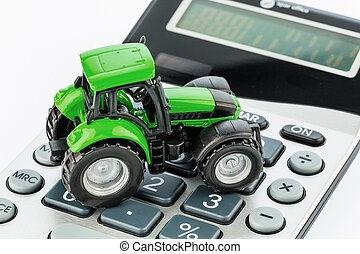 tractor and calculators - a tractor is on a calculator. cost...