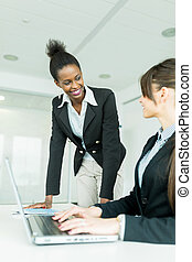Businesswomen exchanging thoughts in a nice office...