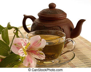 tea ceremony. Green tea, flower and teapot