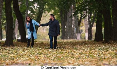 An attractive couple walking in the autumn park