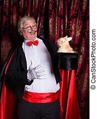Surprised magician with rabbit