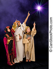 Wisemen watching christmas star - Wisemen played by three...