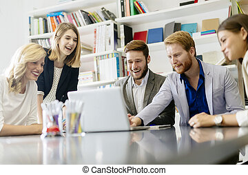 Team of creative people and designers in office smiling and...