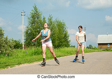 Two Young girls on roller blades - Two young females...