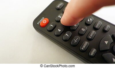TV Remote - Finger Touching The Channel Button On A TV...
