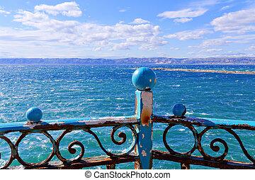 guardrail - rusty blue guardrail on the sea front