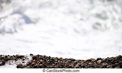 Surf on pebble beach
