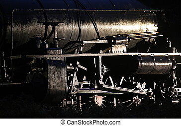 Conceptual low key shot of a historic steam engine.