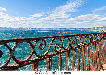 rusty guardrail - rusty blue guardrail on the sea front