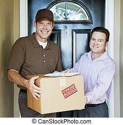 Home Delivery - Delivery man hands package to satisfied...