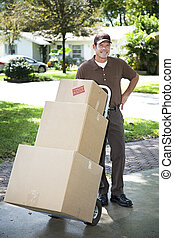 Mover Arrives - Mover or delivery man arrives with a stack...