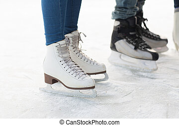 close up of legs in skates on skating rink - people, winter...