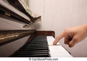 playing piano with one finger
