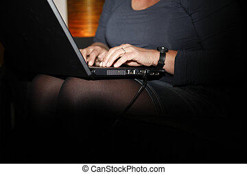 Working on a laptop - Close up of laptop with hands of a...