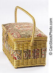 Sewing box - Sewing fabric wicker box isolated over grey...