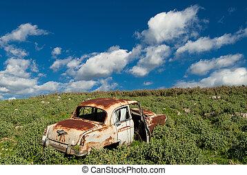 Car in Greece - Rusty car, abandoned in a field in Greece
