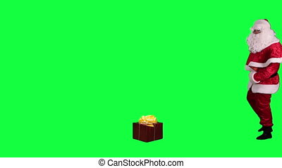 Santa Claus with a gift box - Santa finds a present and...