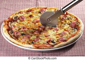 Whole pizza with a knife - Whole pizza with a circle knife...