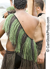 Maori man in traditional clothing seen on back - Traditional...