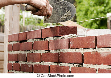 Bricklaying - Bricklayer on construction site