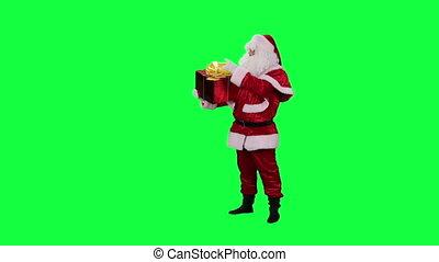 Santa Claus with a gift box - Santa examines present...