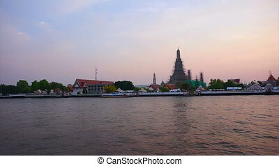 twilight Bangkok river skyline - Pan shot Wat Arun at...