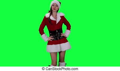 Santa's helper sends an air kiss