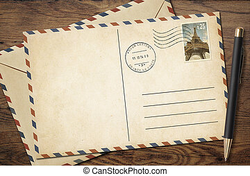 Old vintage postcard and envelope with pen on table - Old...