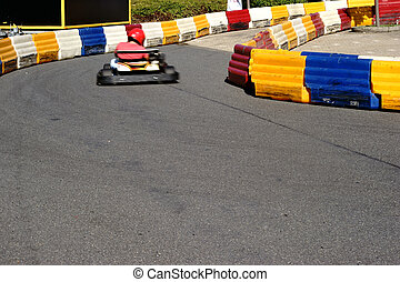 Kart Race - A racer in a kart driving on a limited kart...