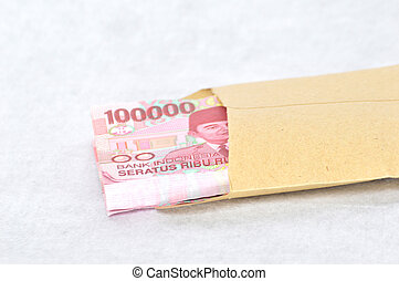 Indonesian paper money in a brown envelope