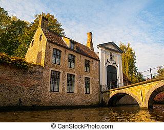Bridge and entrance gate to Begijnhof in Bruges - Bridge and...