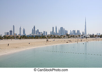 Jumeirah Beach in Dubai. Skyline of the city in the...