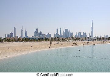 Jumeirah Beach in Dubai. Skyline of the city in the...