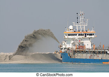 Special dredge ship pipe pushing sand to create new land in...