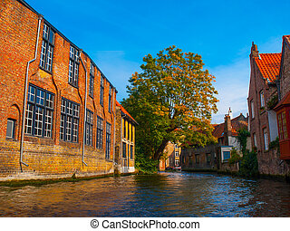 Medieval houses along canals of Bruges in autumn time