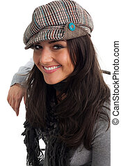 Young woman in cap smile and turn back, isolated