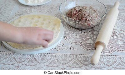childrens hands are preparing pelmeni at home - childrens...