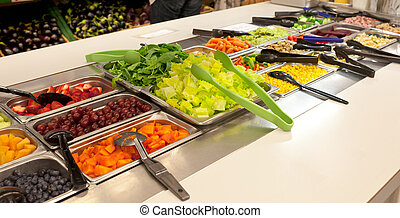 Vegan food buffet with vegetables and fruit.