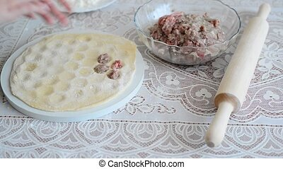 children's hands are preparing pelmeni at home - children's...
