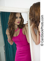 Beautiful Glamour Woman looking in the Mirror at his...