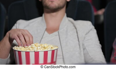 Couple in cinema theater watching a movie